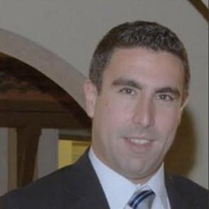 Carlos E Alvarez